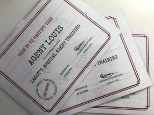Laminated certificates they received on completion of their training